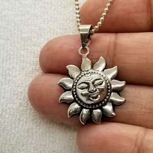 sterling silver chain necklace with a smiling sun